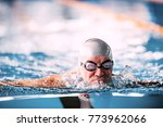 senior man swimming in an... | Shutterstock . vector #773962066