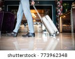 businessman entering hotel with ... | Shutterstock . vector #773962348