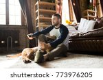 man and dog on the floor at... | Shutterstock . vector #773976205