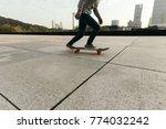 female skateboarder riding with ... | Shutterstock . vector #774032242