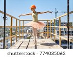 joyful ballerina stands on the...   Shutterstock . vector #774035062