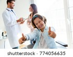 portrait of girl with thumbs up ...   Shutterstock . vector #774056635