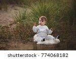 smiling baby girl sdending time ... | Shutterstock . vector #774068182