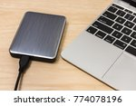 external hard disk on laptop.  ... | Shutterstock . vector #774078196