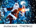 santa claus and winter time  | Shutterstock . vector #774078412