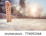 thermometer in the snow with... | Shutterstock . vector #774092368