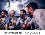 group of young men drinking at... | Shutterstock . vector #774092716