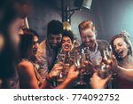 group of friends celebrating at ... | Shutterstock . vector #774092752