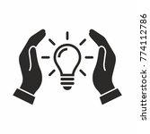 concept of idea. light bulb in... | Shutterstock .eps vector #774112786