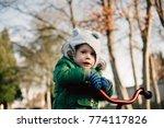 little toddler boy riding a red ... | Shutterstock . vector #774117826