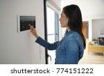 woman using smart wall home... | Shutterstock . vector #774151222