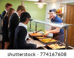 Stock photo teenage students being served meal in school canteen 774167608