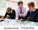 male teacher helping teenage...   Shutterstock . vector #774167626