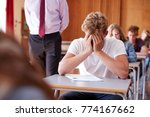 anxious teenage student sitting ... | Shutterstock . vector #774167662