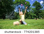 boy juggles with easter eggs... | Shutterstock . vector #774201385
