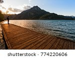 hiker standing on dock end on... | Shutterstock . vector #774220606