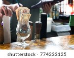 A Glass With Banknotes And...