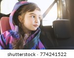 cute girl sitting in a car and... | Shutterstock . vector #774241522