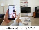 a hand holding a modern generic ... | Shutterstock . vector #774278956