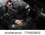 handsome brutal man in the car. ... | Shutterstock . vector #774303832