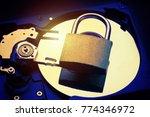 padlock on computer hard disk... | Shutterstock . vector #774346972
