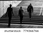 three people leave the metro ... | Shutterstock . vector #774366766