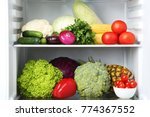 open fridge full of vegetables... | Shutterstock . vector #774367552