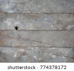 Small photo of old wooden floorboards from loft dirty grey with cracks, dust, plaster drips and signs of age, patina