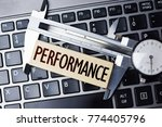 Small photo of Performance measurement or level with caliper on computer notebook