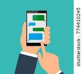 hand holing black smartphone...   Shutterstock .eps vector #774410245