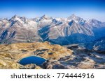 Panoramic view of the swiss alps with Weisshorn, Zinalrothorn and many other major peak with reservoir. From the top of Gornergrat, Zermatt, Switzerland.