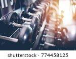 black steel dumbbell set. close ... | Shutterstock . vector #774458125