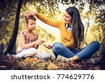 smiling mother with her... | Shutterstock . vector #774629776