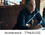business man in a cafe          ...   Shutterstock . vector #774631132