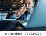angry business man in a cafe ... | Shutterstock . vector #774634372