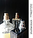 Small photo of Open perfume bottles showing actuator pump.
