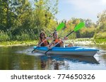 family kayaking  mother and...   Shutterstock . vector #774650326