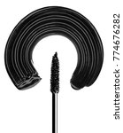 Small photo of mascara brush paints a semicircle on a white surface