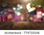 empty wood table top and blur... | Shutterstock . vector #774710146