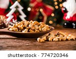 cashew nuts in a bowl on the... | Shutterstock . vector #774720346