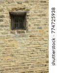 old building window on stone... | Shutterstock . vector #774725938