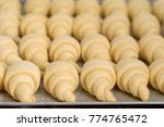close up on raw croissants... | Shutterstock . vector #774765472
