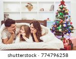 the happy daughter and parents... | Shutterstock . vector #774796258