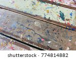 Small photo of Surface of wooden table tainted with paints.