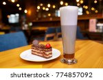 piece of cake and glass of hot...   Shutterstock . vector #774857092