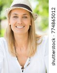 portrait of a smiling woman   Shutterstock . vector #774865012