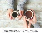 cups of tea in the hands of men ...   Shutterstock . vector #774874336