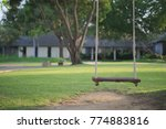 An Empty Swing At A Lawn In A...