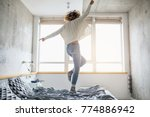 attractive woman jumping on bed ... | Shutterstock . vector #774886942