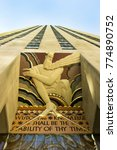 "Small photo of New York City, United States - September 15, 2012: Rockefeller Center entrance featuring The Art Deco sculpture ""Wisdom and knowledge shall be the stability of thy times"" by Lee Lawrie."